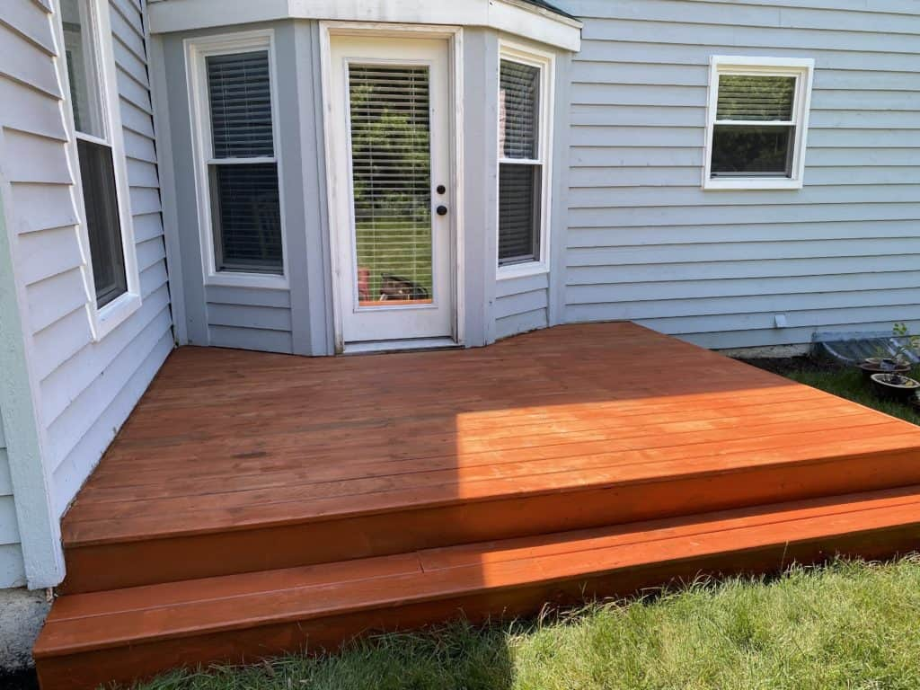 Staining the back porch 3